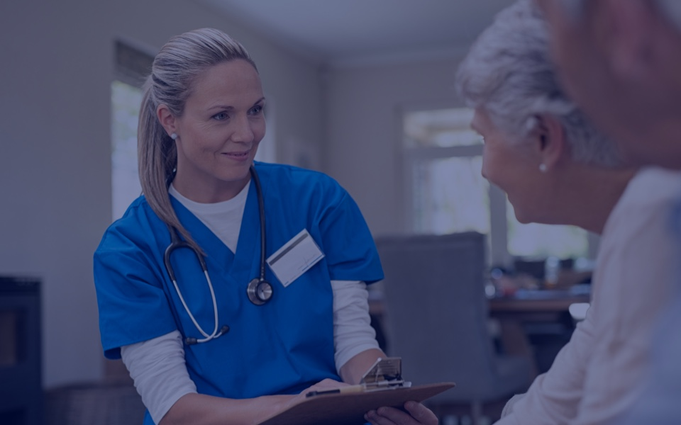 Nurse discussing results with elderly patients