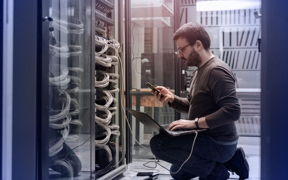 Man troubleshooting server